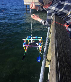 After designing and building his very own ROV, this 8th grade boy lowers the vehicle into the Puget Sound in hopes of retrieving a geological sample from the bottom of the seafloor.